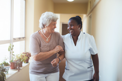 caregiver walking with her patient